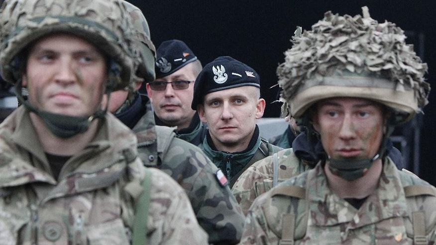 Polish , background, and and British soldiers  take part in joint military exercise  in Swietoszow, Poland, on Friday Nov. 21, 2014.  The British-led exercise  is  involving more than 1,000  British  troops   making it the largest British  commitment sent to Eastern Europe since 2008 and  is part of NATO's reaction to the conflict between Ukraine and Russia.  (AP Photo/Czarek Sokolowski)