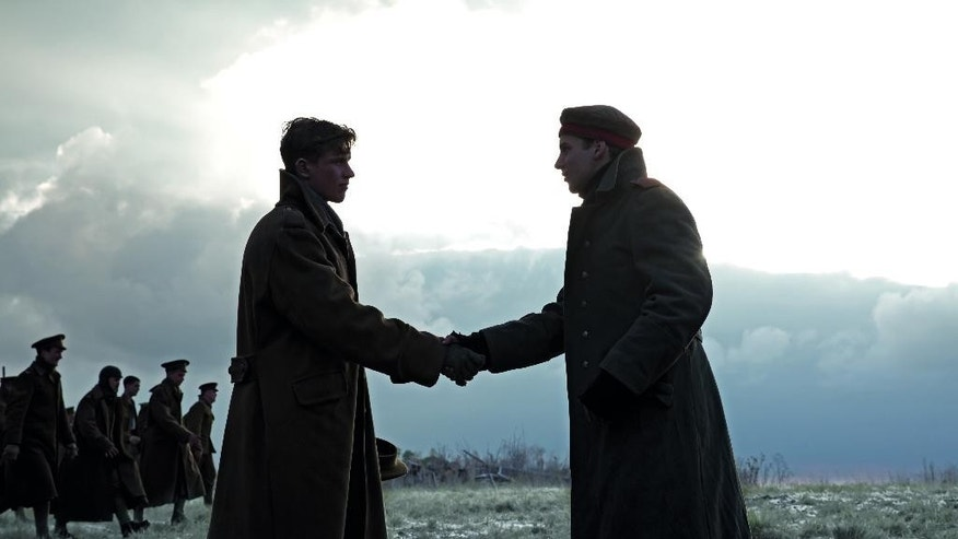 In this handout still image of a television advertisement, released by Sainsbury's on Tuesday, Nov. 18, 2014, two actors dressed as British and German World War I soldiers shake hands. The 40-second mini-movie depicts the 1914 Christmas Truce, when soldiers lay down their arms for a few hours to celebrate the holiday together in no-man's land. (AP Photo/Sainsbury's)