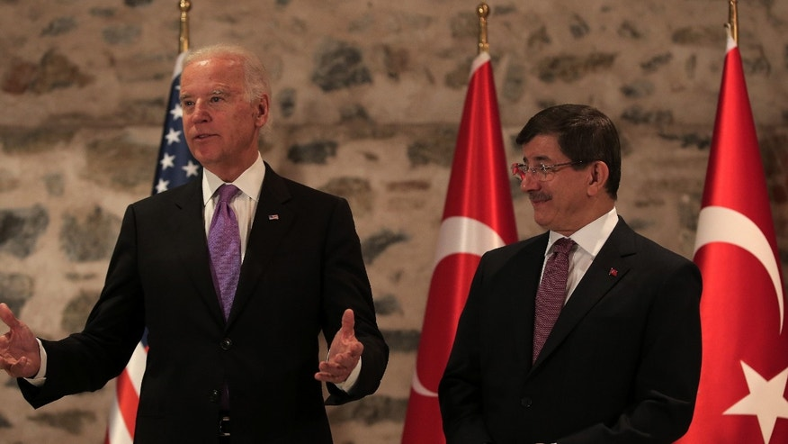 Nov. 21, 2014: U.S. Vice President Joe Biden, left, and Turkish Prime Minister Ahmet Davutoglu speak to the media before a meeting in Istanbul, Turkey