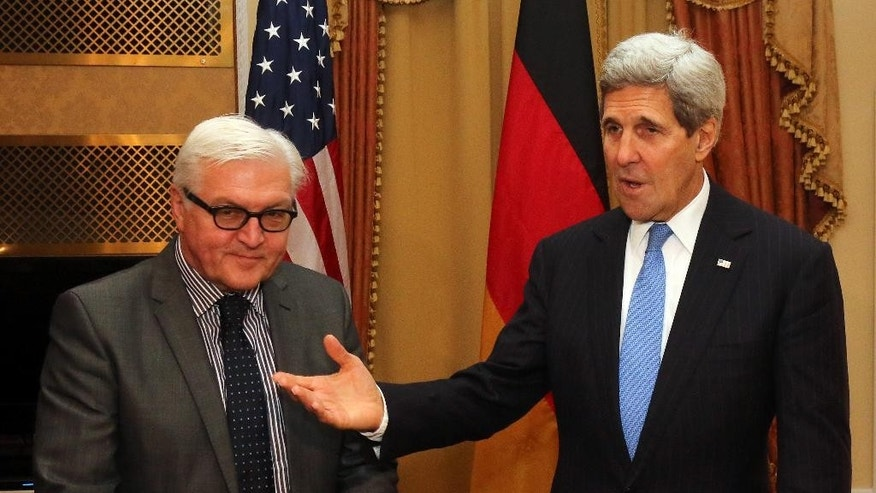 "German Foreign Minister Frank-Walter Steinmeier , left, and U.S. Secretary of State John Kerry,  meet during closed-door nuclear talks with Iran in Vienna, Saturday, Nov. 22, 2014. Iran and six world powers have ""never been closer"" to agreement on a nuclear deal since they started negotiating more than six years ago, but it is up to Tehran to close the gap, Germany's foreign minister said Saturday. High-level comings and goings since Friday also have seen British Foreign Secretary Philip Hammond and French Foreign Minister Laurent Fabius stop by for talks with Kerry, Iranian Foreign Minister Mohammad Javad Zarif  and other participants in the negotiations.  (AP Photo/Ronald Zak)"