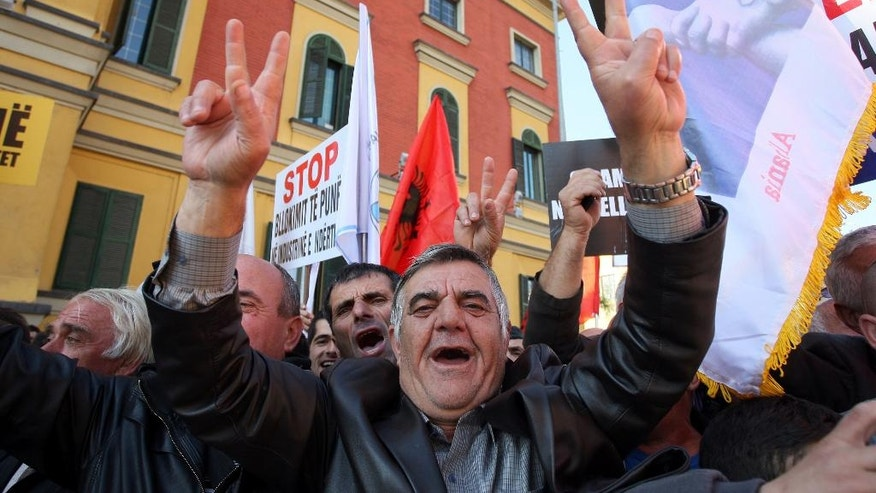 A supporter of Albanian main opposition Democratic Party shouts slogans during a peaceful rally in Tirana on Saturday, Nov. 22, 2014. Tens of thousands of Albanians protested against the government's economic policies, claiming they are leading to rising taxes and energy prices and high unemployment. (AP Photo/Hektor Pustina)