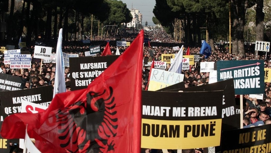 Albanian main opposition Democratic Party supporters take part at a peaceful rally in Tirana on Saturday, Nov. 22, 2014. Tens of thousands of Albanians protested against the government's economic policies, claiming they are leading to rising taxes and energy prices and high unemployment. (AP Photo/Hektor Pustina)