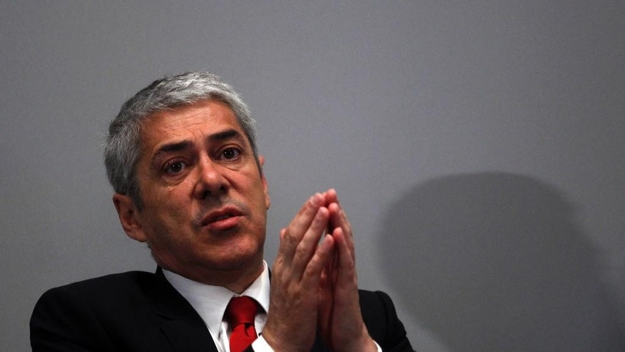 In this May 19, 2011 photo, Portugal's former Prime Minister Jose Socrates gestures as he answers a question during a business conference in Lisbon, Portugal. Portugal's Attorney-General's office says police have detained Socrates Friday, Nov. 21, 2014 as part of an investigation into corruption, money-laundering and tax fraud. (AP Photo/ Francisco Seco)