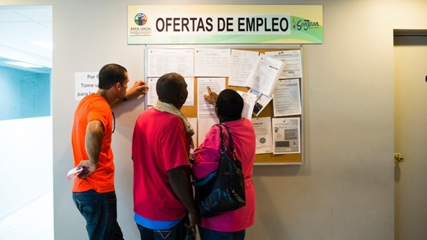 SAN JUAN, PUERTO RICO - NOVEMBER 14:  People scan the bulletin board for job postings at the unemployment office on November 14, 2013  in San Juan, Puerto Rico. The unemployment rate hovers around 14 percent, almost twice the national average. The island-territory of the United States is on the brink of a debt crisis as lending has skyrocketed in the last decade with the government issuing municipal bonds. Market analysts have rated those bonds as junk and suspect it's 70 billion dollar debt might be unserviceable in the near future. With a deteriorating manufacturing industry and tourism only contributing to 10 percent of the GDP, the way out is unclear.  (Photo by Christopher Gregory/Getty Images)