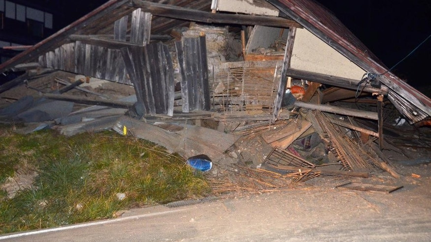 A house is collapsed after a strong earthquake hit in Hakuba, Nagano Prefecture, central Japan, Saturday, Nov. 22, 2014. The magnitude-6.8 earthquake struck the mountainous area of central Japan Saturday night, causing at least one building to collapse and injuring several people, according to Japanese media reports. No tsunami warning was issued. (AP Photo/Kyodo News) JAPAN OUT, CREDIT MANDATORY