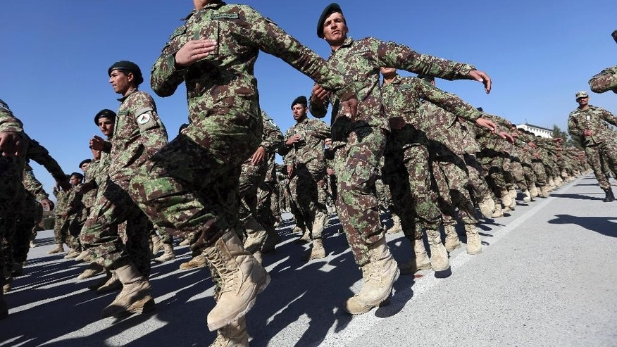 New members of the Afghan National Army march during their graduation ceremony at the Afghan Military Academy in Kabul, Afghanistan, Sunday, Nov. 23, 2014. Afghanistan's parliament approved agreements Sunday with the U.S. and NATO allowing international troops to remain in the country past the end of this year amid a renewed offensive by Taliban militants. The international combat mission in Afghanistan, begun after the 2001 U.S.-led invasion that toppled the Taliban, was to conclude at the end of this year. The new agreements ratified by parliament allow the U.S. and NATO to keep a total of 12,000 troops in Afghanistan next year to support local forces. (AP Photo/Rahmat Gul)