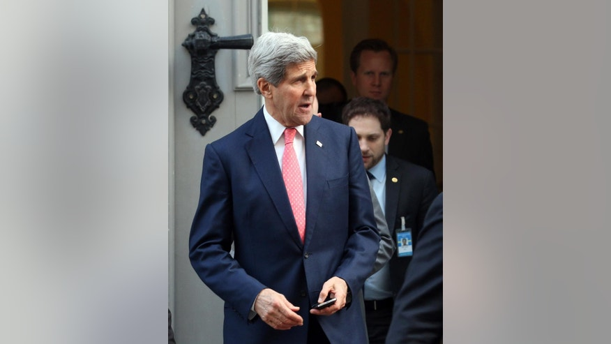 U.S. Secretary of State John Kerry leaves Palais Coburg where closed-door nuclear talks with Iran take place in Vienna, Austria, Sunday, Nov.23, 2014. (AP Photo/Ronald Zak)