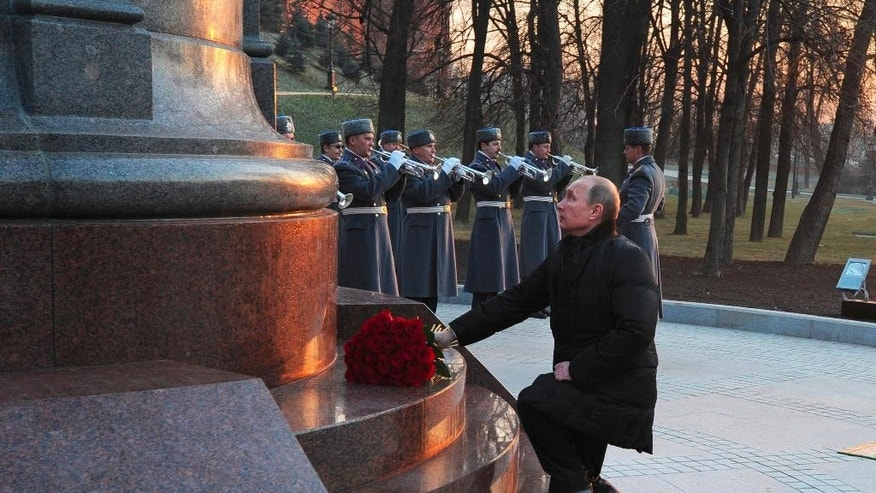 Nov. 20, 2014: Russian President Vladimir Putin lays flowers at a monument to Russian Czar Alexander I during an unveiling ceremony in Alexander Gardens at the Kremlin wall in Moscow. (AP/RIA-Novosti, Mikhail Klimentyev, Presidential Press Service)