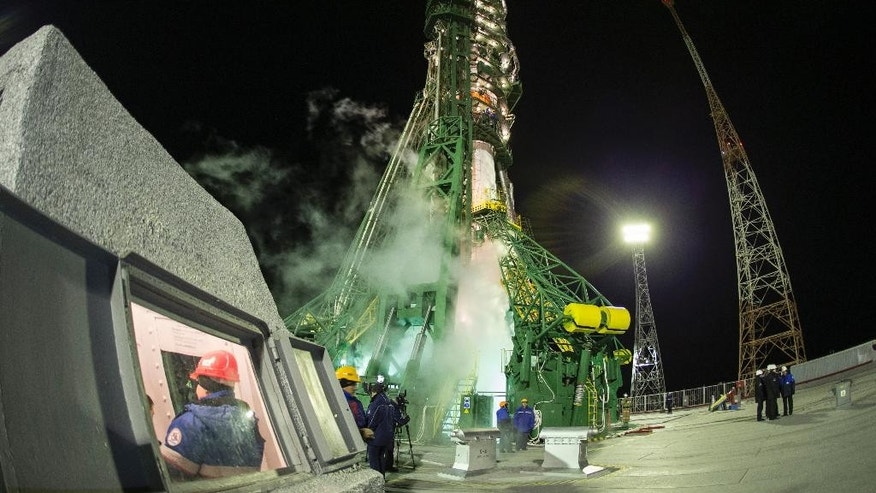 Russia's Soyuz-FG booster rocket with the space capsule Soyuz TMA-15M that will carry a new crew to the International Space Station (ISS), at the launch pad at the Russian leased Baikonur cosmodrome, Kazakhstan, Monday, Nov. 24, 2014.  (AP Photo/Shamil Zhumatov, Pool)
