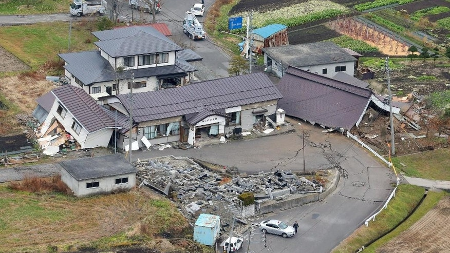Nov. 23, 2014: This aerial photo shows buildings collapsed after a strong earthquake hit Hakuba, Nagano prefecture, central Japan. (AP/Kyodo News)