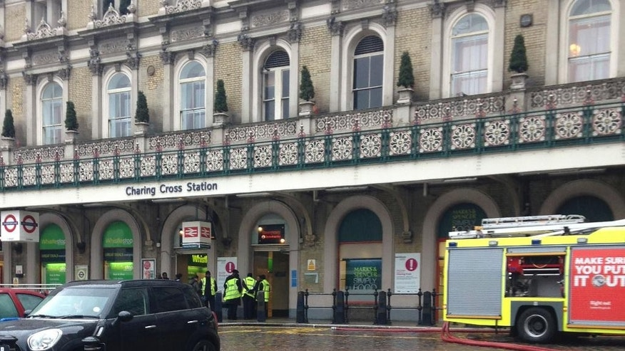 "The front of Charing Cross train station in central London, which was evacuated as emergency services dealt with a fire on a train, Sunday Nov. 23, 2014. London Fire Brigade said that the ""small fire"" on a front carriage had been brought under control at the London station. (AP Photo/Olivia Rudgard, PA) UNITED KINGDOM OUT - NO SALES - NO ARCHIVES"