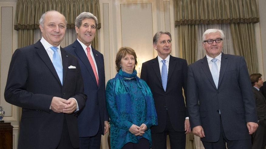 From left, French Foreign Minister Laurent Fabius, U.S. Secretary of State John Kerry, former EU Foreign Policy Chief Catherine Ashton, British Foreign Secretary Philip Hammond and German Foreign Minister Frank-Walter Steinmeier pose for photos prior to a dinner at the residence of British ambassador, in Vienna, Austria, Sunday, Nov. 23, 2014. (AP Photo/Joe Klamar, Pool)