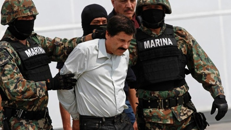 "Joaquin ""El Chapo"" Guzman is escorted to a helicopter in handcuffs by Mexican navy marines at a navy hanger in Mexico City, Saturday, Feb. 22, 2014. A senior U.S. law enforcement official said Saturday, that Guzman, the head of MexicoÃs Sinaloa Cartel, was captured alive overnight in the beach resort town of Mazatlan. Guzman faces multiple federal drug trafficking indictments in the U.S. and is on the Drug Enforcement AdministrationÃs most-wanted list. (AP Photo/Marco Ugarte)"