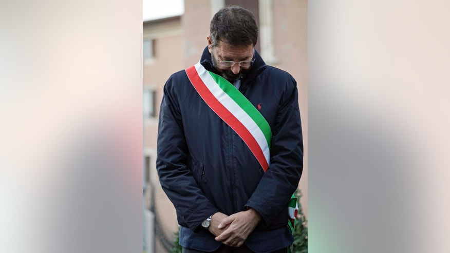 In this photo taken in Rome, Friday, Nov. 21, 2014, Rome mayor Ignazio Marino attends a ceremony. Ignazio Marino promised to bring order to Rome's chaos when he was elected mayor in a landslide in June last year. Instead, critics say the liver transplant surgeon is the affliction not the cure, and are pressuring him to resign. (AP Photo/Andrew Medichini)