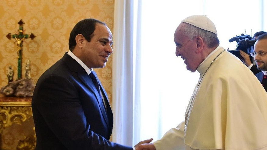 Pope Francis shakes hand with Egyptian President Abdel-Fattah el-Sissi during a meeting at the Vatican, Monday, Nov. 24, 2014. (AP Photo/Gabriel Bouys, Pool)