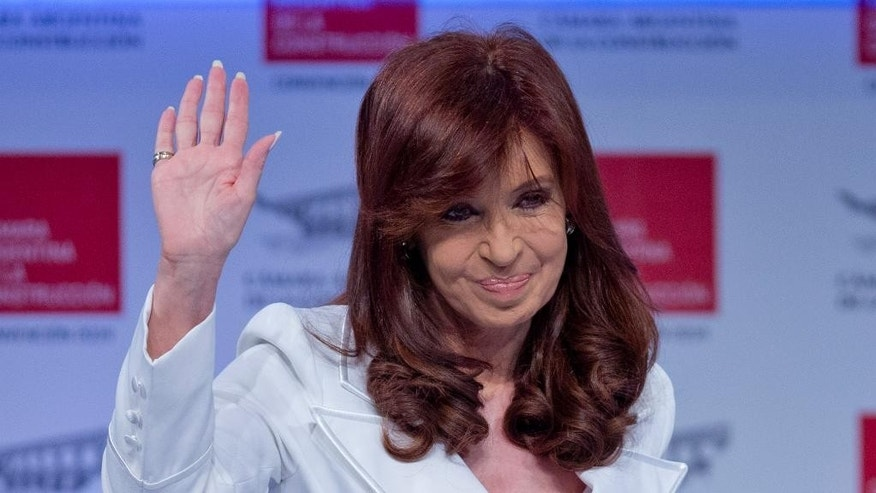 Argentina's President Cristina Fernandez greets the public after she arrives at the Argentine Chamber of Construction annual convention in Buenos Aires, Argentina, Tuesday, Nov. 25, 2014. Fernandez appeared for the first time in public after more than 20 days, after recovering of a bacterial infection. (AP Photo/Natacha Pisarenko)