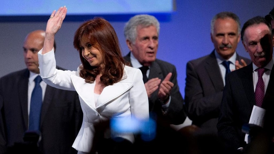 Argentina's President Cristina Fernandez arrives at the Argentine Chamber of Construction annual convention in Buenos Aires, Argentina, Tuesday, Nov. 25, 2014. Fernandez appeared for the first time in public after more than 20 days, after recovering of a bacterial infection. (AP Photo/Natacha Pisarenko)