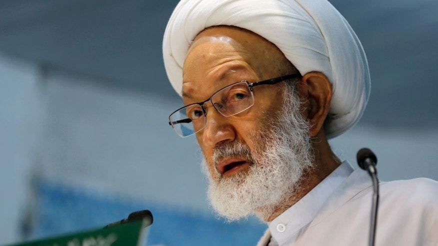 In this photo taken Nov. 21, 2014, Sheik Isa Qassim, Bahrain's top Shiite Muslim cleric, speaks during midday prayers Friday, in the village of Diraz, Bahrain. Bahrain's leading Shiite opposition group says security forces have raided the home of the country's most prominent Shiite cleric. (AP Photo/Hasan Jamali)