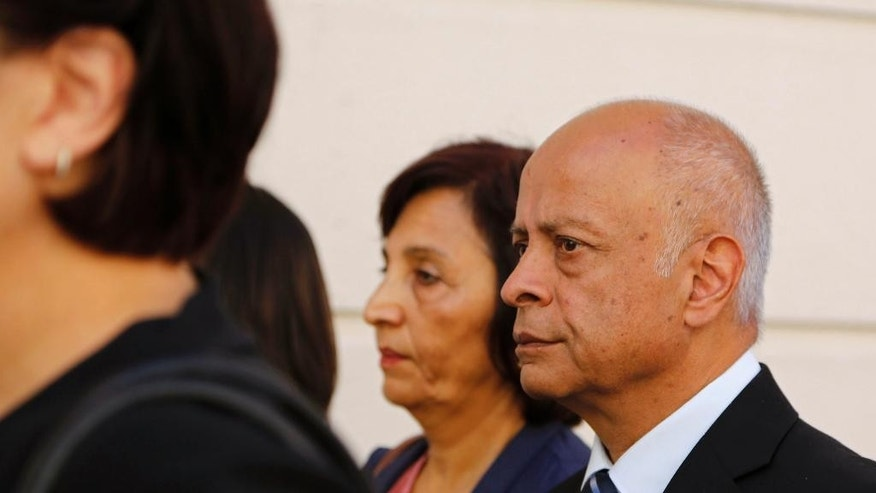 Prakash Dewani, right, and Snila Dewani, center, the parents of British businessman Shrien Dewani, arrive at the high court in the city of Cape Town, South Africa, Tuesday, Nov. 25, 2014. British businessman and accused murder suspect Shrien Dewani is charged with orchestrating the murder of his wife, Anni, while the newly-married couple were on honeymoon in South Africa in 2010. (AP Photo/Schalk van Zuydam)
