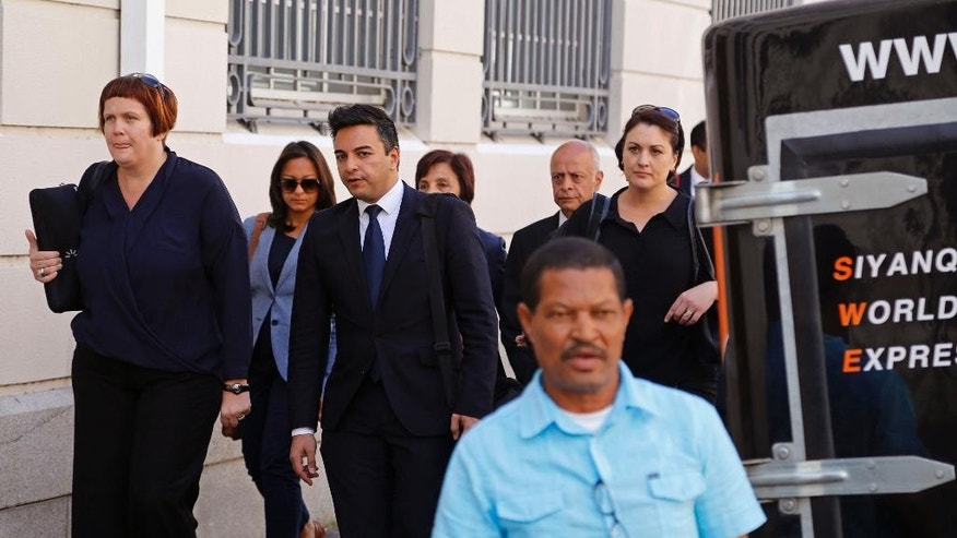 Preyen Dewani, third left, the brother of murder accused Shrien Dewani, arrives at the high court in Cape Town, South Africa, Tuesday, Nov. 25, 2014. British businessman and accused murder suspect Shrien Dewani is charged with orchestrating the murder of his wife, Anni, while the newly-married couple were on honeymoon in South Africa in 2010. (AP Photo/Schalk van Zuydam)