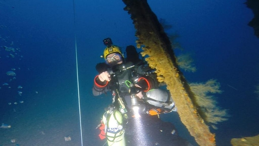 In this Jan. 25, 2014 image from video provided by Definitive Productions, diver Sandy Varin examines the underwater shipwreck of the S.S. Ventnor near Whangarei, off the northern New Zealand coast. The S.S. Ventnor sank 112 years ago off the northern New Zealand coast, bearing the exhumed bodies of 499 Chinese miners. They had tried their luck in New Zealand's gold rush, and had paid in advance to ensure their bodies would go back to China, no matter what. The wreck was discovered in 2012, raising the possibility that someday, the remains might go home. (AP Photo/Definitive Productions)