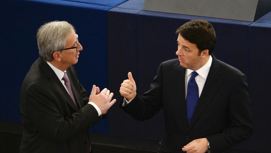 Jean-Claude Juncker, left, President of the European Commission, and Italy's Prime Minister Matteo Renzi discuss at the European Parliament, Tuesday Nov. 25, 2014 in Strasbourg, eastern France. (AP Photo/Patrick Seeger, Pool)