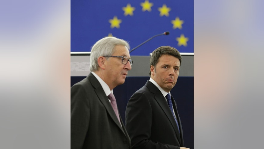 Italian Premier Matteo Renzi, right, and President of the European Commission Jean-Claude Juncker arrive at the EU Parliament in Strasbourg, France, Tuesday, Nov. 25, 2014. Pope Francis has demanded Europe craft a unified and fair immigration policy, saying the thousands of refugees coming ashore need acceptance and assistance, not self-interested policies that risk lives and fuel social conflict. Francis made the comments Tuesday to the European Parliament during a brief visit meant to highlight his vision for Europe a quarter-century after St. John Paul II travelled to Strasbourg to address a continent still divided by the Iron Curtain. (AP Photo/Andrew Medichini)