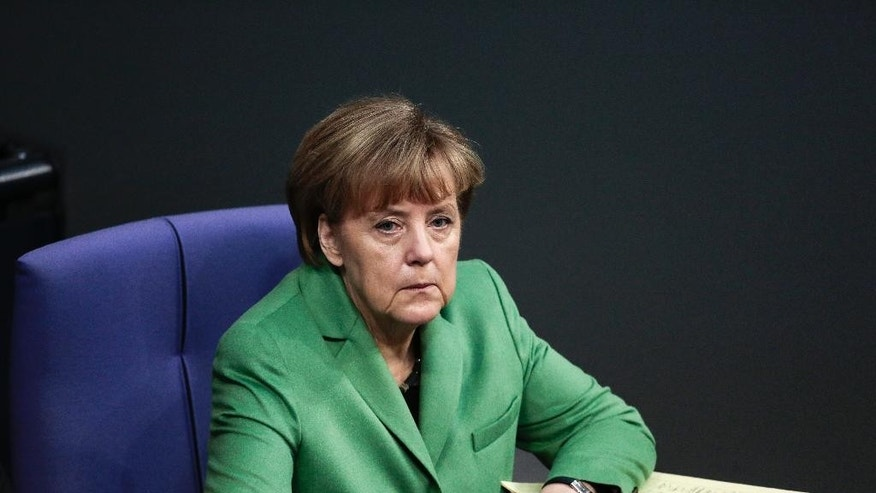 German Chancellor Angela Merkel attends the final four days debate of a debt free national budget for 2015 at the parliament Bundestag in Berlin, Germany, Tuesday, Nov. 25, 2014. (AP Photo/Markus Schreiber)