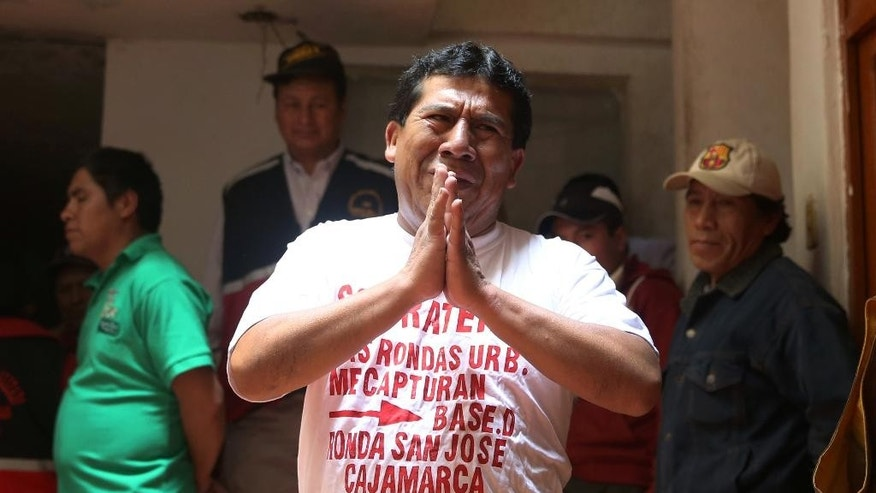 "In this May 12, 2014 photo, alleged serial pickpocket Dario Goicochea, 42, begs for mercy and claims his innocence as he tries to evade lashes by citizen vigilantes known as ""rondas urbanas,"" or urban patrols, in Cajamarca, Peru. A dozen lashes later, he confessed, and paid $60 to a woman whose cell phone he'd allegedly stolen. ""That's how we deal with this kind of thief,"" said the citizen patrol's leader, Fernando Chuquilin, who personally landed the last lash. (AP Photo/Martin Mejia)"