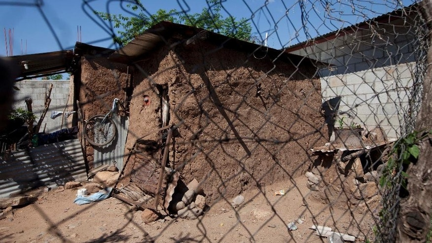 In this May 27, 2014 photo, the home of late Jose Miguel Ramirez, who was found dumped by a stream with a bullet hole above his left eye, stands abandoned in Zacapa, Guatemala. The case of 19-year-old Ramirez, whose body was found outside the ZacapaEx plantation in March 2013, reveals just how convoluted security and justice have become in Guatemala, where private guards outnumber police 5-to-1, and the soaring crime rate is married with shocking levels of impunity. (AP Photo/Moises Castillo)