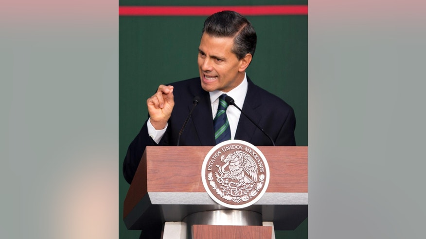 Mexico's President Enrique Pena Nieto speaks during a ceremony at the National Palace in Mexico City, Thursday, Nov. 27, 2014. Mexico's president announced a new anti-crime plan that includes proposals for a nationwide ID, giving Congress the power to dissolve corrupt municipal government and fold their often-corrupt local police forces under the control of the country's 31 state governments. The plan would also streamline the complex divisions between federal, state and local offenses. At present, some local police refuse to act to prevent federal crimes like drug trafficking.  The plan would focus first on four of Mexico's most troubled states, Guerrero, Michoacan, Jalisco and Tamaulipas. It would also send more federal police and other forces to those states. (AP Photo/Eduardo Verdugo)