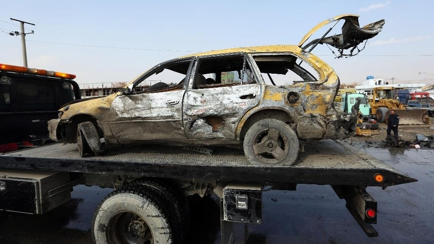 Nov. 27, 2014: A damaged vehicle at the site of a suicide attack in Kabul, Afghanistan