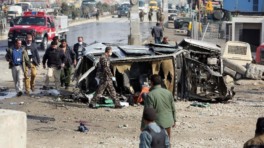 A closed circuit security camera shows Afghan security forces responding to an attack on a compound in Kabul, Afghanistan, Thursday, Nov. 27, 2014. Afghan police say that a loud explosion has been heard in the Afghan capital Kabul, followed by gunfire. Gen. Mohammad Zahir, Kabul's police chief, says that the gunfire Thursday night took place in an area of the city where the First Deputy President Abdul Rashid Dostum has a heavily fortified compound.(AP Photo)