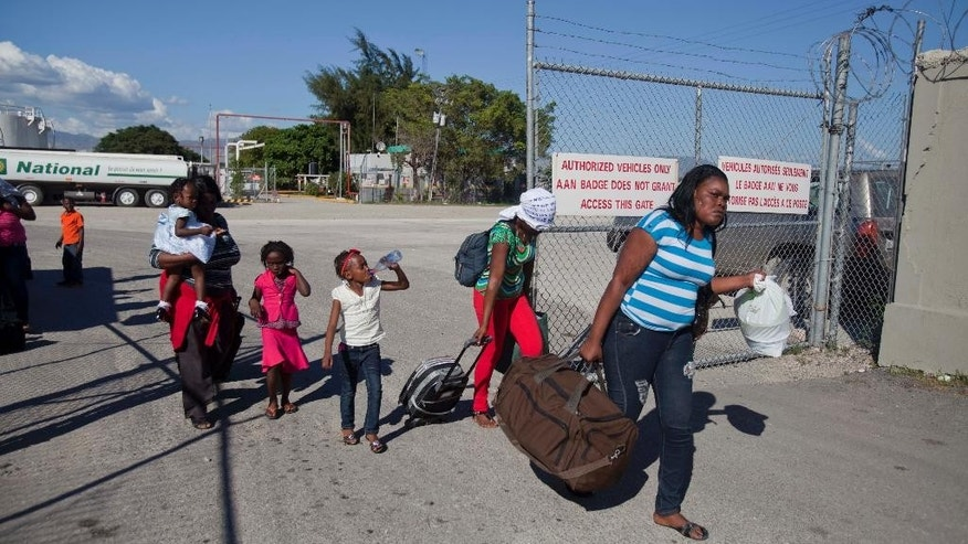 Haitians repatriated from the Bahamas leave the Toussaint Louverture International Airport, after landing in Port-au-Prince, Haiti, Wednesday, Nov. 26, 2014. Under the new immigration rules in the Bahamas, that took effect Nov. 1, everyone must have the passport of their nationality and, if they are not a Bahamian, a valid residency or work stamp. In addition, the government is tightening the process for employers to receive work permits for non-Bahamians and requiring first-time applicants for residency permits to apply in their home countries. (AP Photo/Dieu Nalio Chery)
