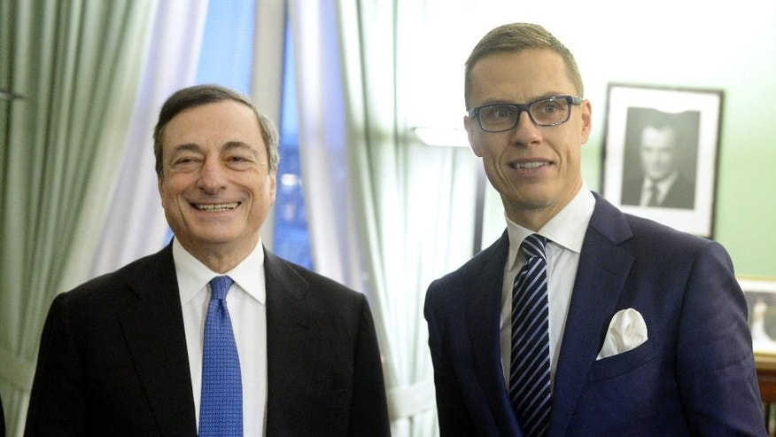 The President of the European Central Bank Mario Draghi, left, and Finnish Prime Minister Alexander Stubb pose for photos before their meeting in Helsinki, Finland, Thursday Nov. 27, 2014. (AP Photo/Lehtikuva, Vesa Moilanen) FINLAND OUT. NO SALES