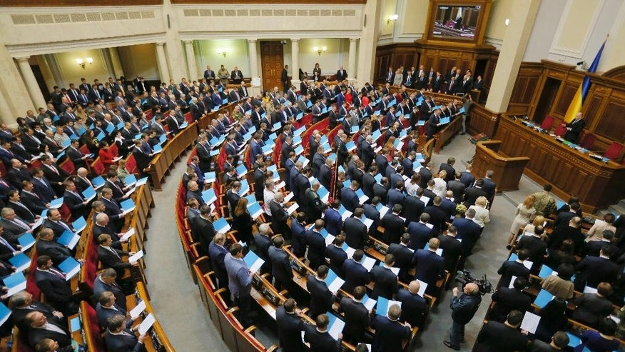 Newly elected Ukrainian parliament deputies swear their oath during the inauguration cermeony in Kiev, Ukraine, Thursday, Nov. 27, 2014. Ukraine Parliament has opened for its first session since an election last month that ushered in a spate of pro-Western parties. (AP Photo/Sergei Chuzavkov)