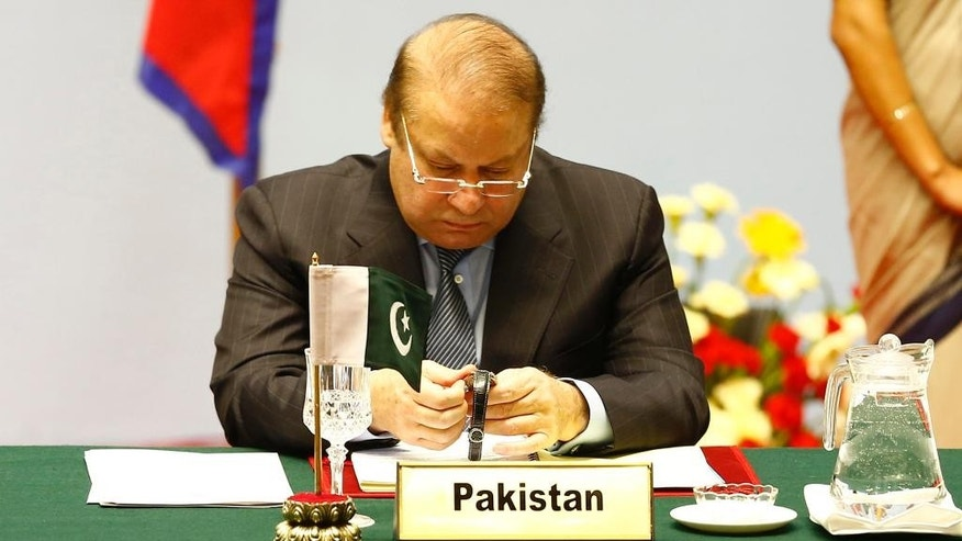 Pakistani Prime Minister Nawaz Sharif looks at his watch during the 18th summit of the South Asian Association for Regional Cooperation (SAARC) in Katmandu, Nepal, Wednesday, Nov. 26, 2014. The South Asian Association for Regional Cooperation summit, the first since 2011, is meant as a forum to discuss regional issues, but is usually dominated by the rivalry between Pakistan and India. (AP Photo/Narendra Shrestha, Pool)