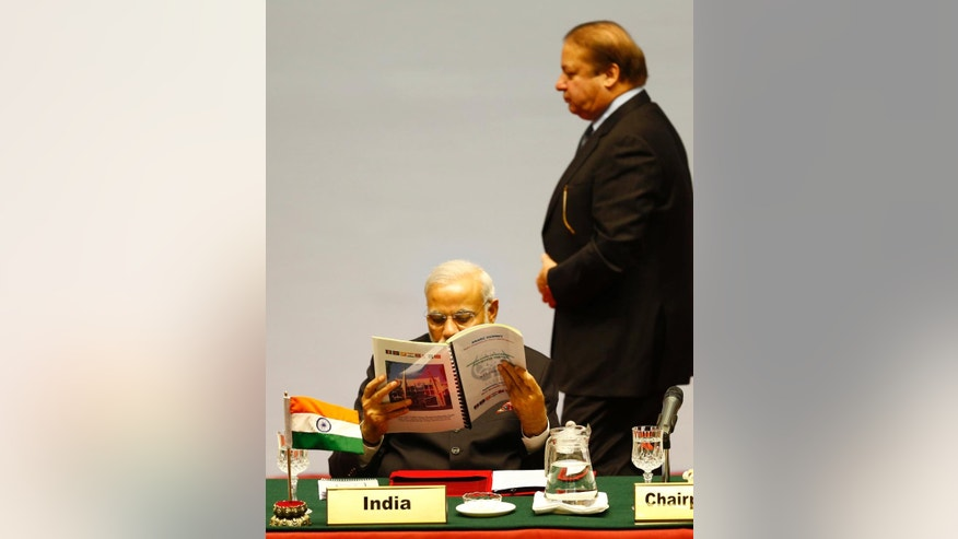 Pakistani Prime Minister Nawaz Sharif walks past Indian Prime Minister Narendra Modi during the 18th summit of the South Asian Association for Regional Cooperation (SAARC) in Katmandu, Nepal, Wednesday, Nov. 26, 2014. Leaders from Afghanistan, Bangladesh, Bhutan, India, Maldives, Nepal, Pakistan and Sri Lanka gathered in Nepal's capital Wednesday to boost cooperation in trade and energy and seek greater peace in the region, home to more than a fifth of the world's population. (AP Photo/Narendra Shrestha, Pool)