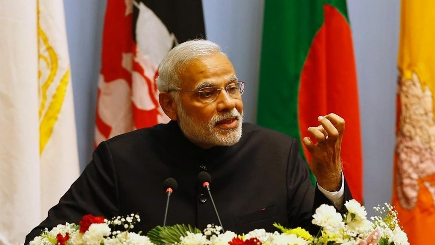 Indian Prime Minister Narendra Modi speaks during the 18th summit of the South Asian Association for Regional Cooperation (SAARC) in Katmandu, Nepal, Wednesday, Nov. 26, 2014. The South Asian Association for Regional Cooperation summit, the first since 2011, is meant as a forum to discuss regional issues, but is usually dominated by the rivalry between Pakistan and India. (AP Photo/Narendra Shrestha, Pool)