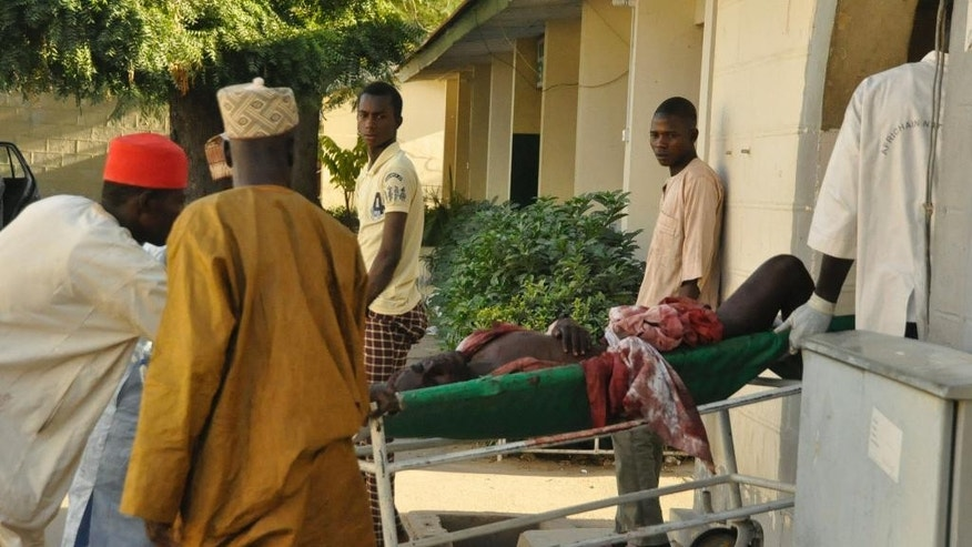 A injured man is wheeled into hospital, following an explosion at a Mosque, in Kano, Nigeria, Friday Nov. 28, 2014. An explosion tore through the central mosque in Nigeria's second-largest city on Friday, and officials feared the casualty toll would be high. Capt. Ikechukwu Eze said the Friday blast occurred at the main mosque in the city of Kano. Hundreds had gathered to listen to a sermon in a region terrorized by attacks from the militant group Boko Haram. (AP Photo/Muhammed Giginyu)