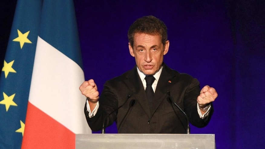 FILE - In this Nov.22, 2014 file photo, France's former president Nicolas Sarkozy, candidate for the presidency of the French right-wing main opposition party UMP gestures as he delivers a speech during a meeting,  in Bordeaux, southwestern France. Sarkozy is the frontrunner as French conservatives choose their new leader over the next two days, a crucial step in his bid to win back the country's presidency. (AP Photo Bob Edme, File)