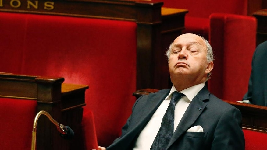 French Foreign Minister Laurent Fabius, pauses during a debate on the recognition of the Palestinian at the French Parliament in Paris, Friday, Nov. 28, 2014. France's government is pushing to revive Israeli-Palestinian peace talks, amid growing pressure across Europe for recognition of a Palestinian state after decades of Mideast stalemate. (AP Photo/Michel Euler)