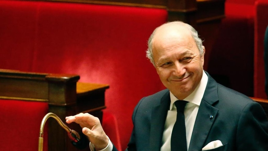 French Foreign Minister Laurent Fabius, smiles during a debate on the recognition of the Palestinian at the French Parliament in Paris, Friday, Nov. 28, 2014. France's government is pushing to revive Israeli-Palestinian peace talks, amid growing pressure across Europe for recognition of a Palestinian state after decades of Mideast stalemate. (AP Photo/Michel Euler)
