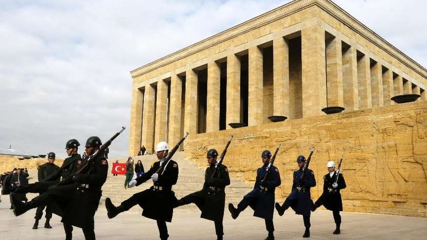 Soldiers march in front of the mausoleum of Mustafa Kemal Ataturk, the founder of modern Turkey, in Ankara on Thursday, Nov. 27, 2014. Pope Francis travels to Turkey this weekend amid new Muslim-Christian tensions and a violent war next door, with Islamic State militants seizing chunks of territory in Iraq and Syria and sending 1.6 million refugees across the border into Turkey. (AP Photo/Thanassis Stavrakis)