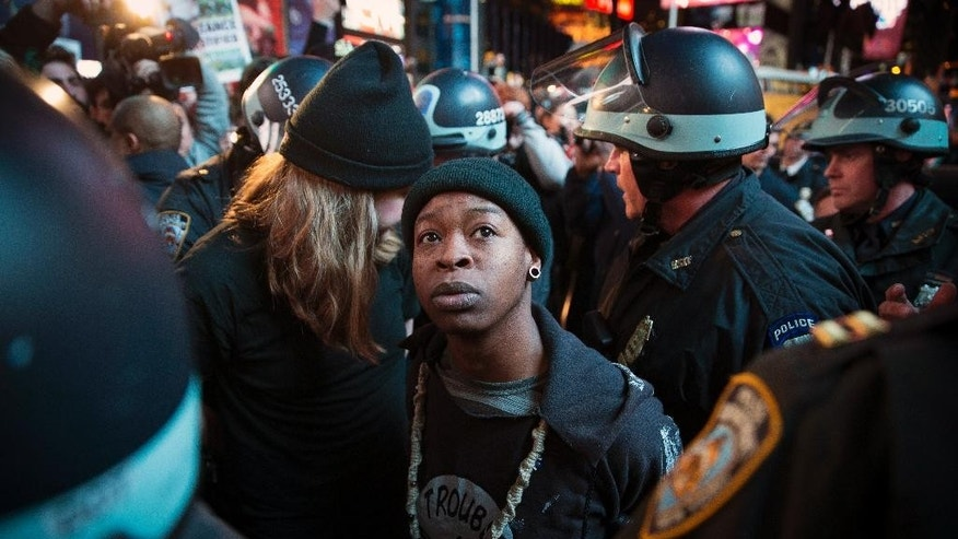 A demonstrator is arrested on Tuesday, Nov. 25, 2014, in New York.