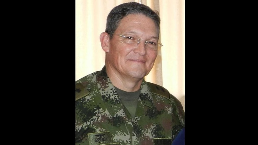 This Aug. 15, 2014 photo released by Colombia's Army press office shows Colombian Army Gen. Ruben Dario Alzate in Colombia. On Saturday, Nov. 29, 2014, Colombia's main rebel group says it's begun the process of freeing Alzate. The move should revive peace talks between the rebels and Colombia's government that are being held in Cuba. President Juan Manuel Santos had suspended 2-year-old talks after the general, a captain and an attorney were seized in a conflictive part of western Colombia on Nov. 16. (AP Photo/Colombian Army press office, File)