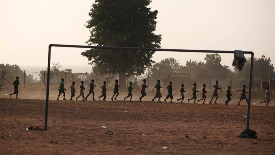 Internally displaced Children who fled their homes following an attack by Islamist militants in North East, Nigeria, run round a soccer ground at a camp in Yola, Nigeria, Friday Nov. 28, 2014.  Some thousands of people have fled their homes in recent times due to Boko Haram attacks. (AP Photo/Sunday Alamba )