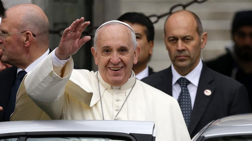 "Pope Francis waves to journalists as he leaves the Blue Mosque in Istanbul, Turkey, Saturday, Nov. 29, 2014. Pope Francis visits two of Turkey's most iconic sites and shifts gears toward more religious affairs as he arrives in Istanbul for the second leg of his three-day visit to the Muslim nation. The Vatican says Francis will tour Istanbul's Sultan Ahmet mosque on Saturday and pause for a moment of ""reflection."" (AP Photo/Thanassis Stavrakis)"