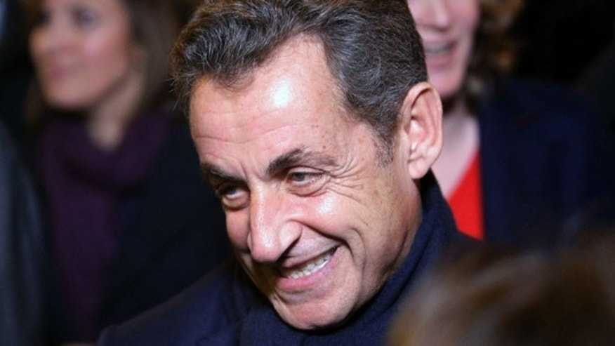 Nov. 29, 2014: Former French President Nicolas Sarkozy leaves his headquarters, in Paris. (AP)