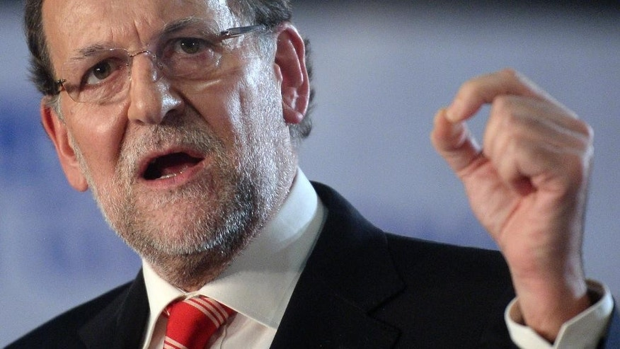 "Spain's Prime Minister Mariano Rajoy gestures during his speech in Barcelona, Spain, Saturday, Nov. 29, 2014. Spain's prime minister has visited the northern region of Catalonia 20 days after its government held an informal, nonbinding poll asking residents if they favored splitting from Spain. Rajoy, who was surrounded by many of his Cabinet ministers, said two-thirds of Catalans had not turned out to vote in the consultation and that the regional government's ""international propaganda operation"" had fallen apart ""noiselessly and without clatter"". Catalan officials said out of 6.3 million potential voters, 2.3 million cast ballots, with most favoring secession. (AP Photo/Manu Fernandez)"